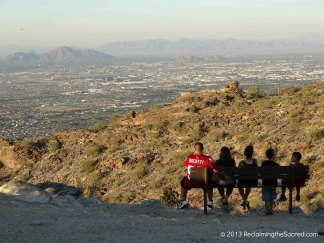 Tourists enjoy the view of Phoenix, Arizona from one of the many stunning locations that encircle the hot, desert city.