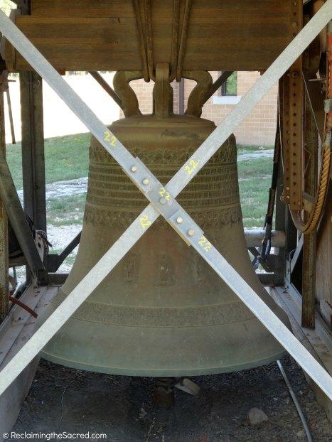 The bell itself, hidden behind its temporary scaffolding.