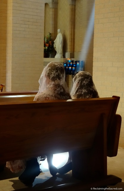 Two sisters, visiting Clear Creek Abbey, sit together in prayer.